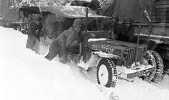 Pushing a jeep in snow